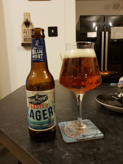 Rating: 3.0/5, 'Toasted Lager' by Blue Point at first made me uncertain, but upon drinking more of the bottle, it definitely grew on me